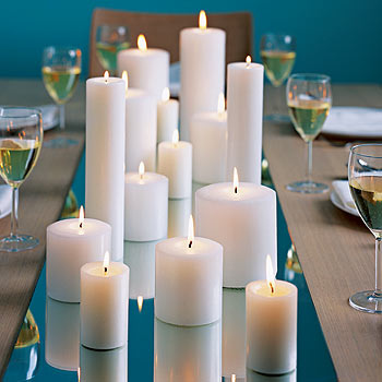 Add a touch of romance to your wedding by placing candles of varying heights